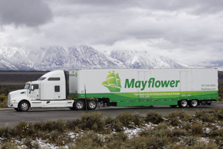 Metcalf Moving Truck on highway with mountains in background