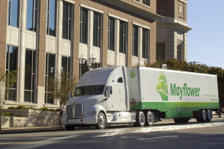 Metcalf Moving Truck in front of building