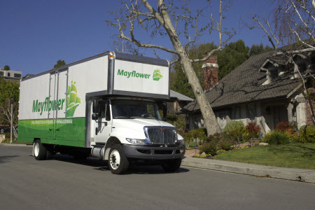 Metcalf Moving Truck in front of house